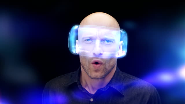 Man in virtual reality glasses frowning and closing his eyes. Looking at imaginary, fascinating object video