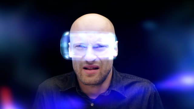 Man in virtual reality glasses frowning and closing his eyes. Looking at imaginary, disgusting object video