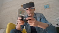 Man in VR Glasses Playing Immersive Video Game video