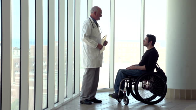 Man in wheelchair talking with doctor video