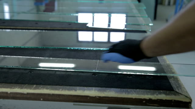 Man is breaking narrow piece of glass video