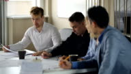 Man is offering new blueprint to colleagues video