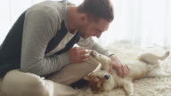 Man is Playing with Shiba Dog in Living Room. video