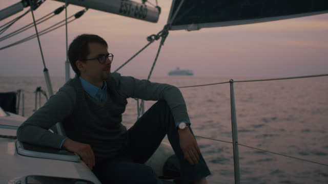 Man is relaxing on a yacht in the sea. video
