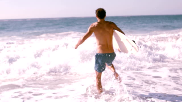 A man is running with his surfboard video