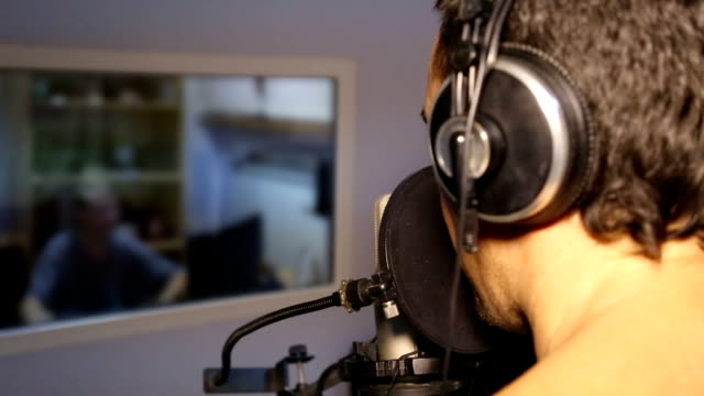 man is singing in a recording studio video