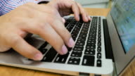 Man is Typing on Laptop Keyboard on Wood Table, Dolly Shot video