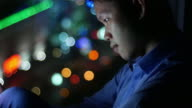 Man is using smart phone with light bokeh background video