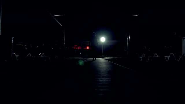 A man is walking alone in the dark on the streets video