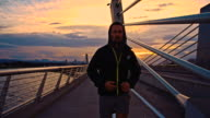 TS Man Jogging Across The Bridge At Dusk video