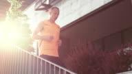 SLO MO TS Man jogging along a business building video