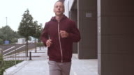 SLO MO TS Man jogging along a city street video