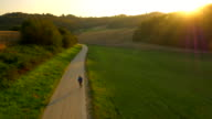AERIAL Man Jogging In The Countryside At Sunset video