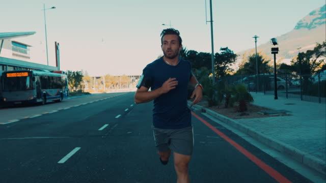 Man jogging in urban setting video