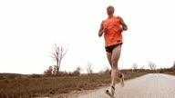 SLO MO TS Man jogging on a country road video