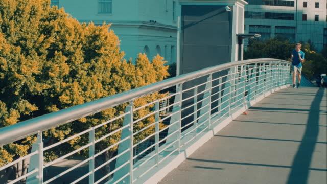 Man jogging on bridge video