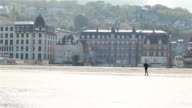 Man jogging on the beach in Trouville, France, Europe video