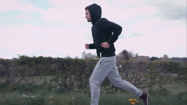 Man jogging outdoors video