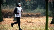 A man jogging, running in park. video