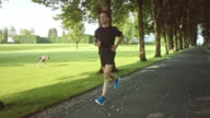 SLO MO TS Man jogging listening to music video