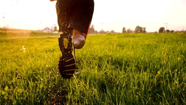 TS Man Jogging Through Wet Grass video