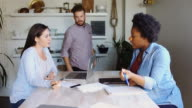 Man Joining Female Colleagues at  Table video