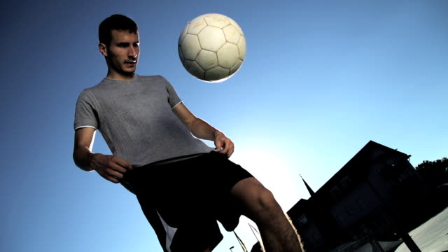 HD SUPER SLOW-MO: Man Juggling A Ball video