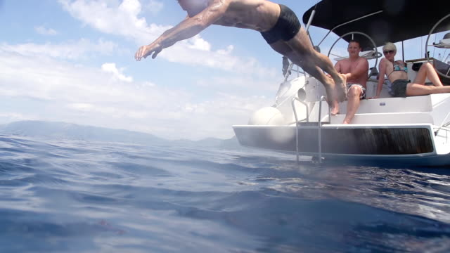 SLO MO Man Jumping From A Boat video