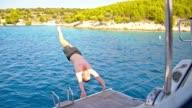 SLO MO Man jumping from a sailboat video