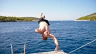 SLO MO Man jumping into the sea from a sailboat video