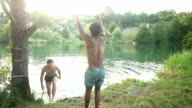 Man jumping off rope swing into river video