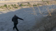 Man Jumps Down Embankment Near US and Mexico Border video