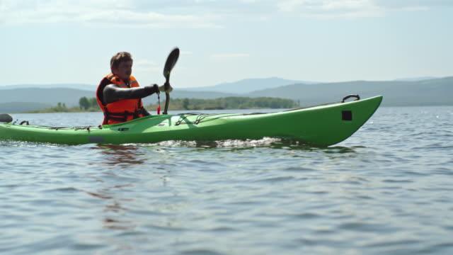 Man Kayaking on Lake video