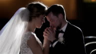 Man kiss hand of woman close up studio light. Groom kind taking care of bride kiss forehead romantic tenderness affection love marriage wedding vows concept. Couple in love fond of as two young doves video