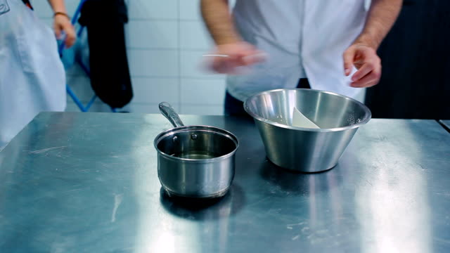 Man knead the dough from water and flour video