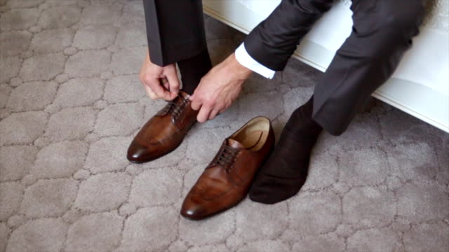 A Man Lacing Up Shoes video