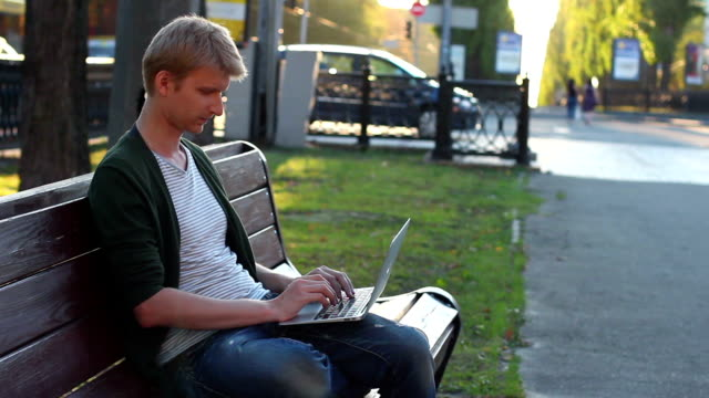 Man laptop turns seriously looks, success, victory, development video