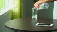 Man Lay Smart Phone And Pour Water video