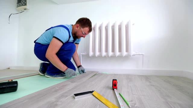 Man Laying floor Laminate video