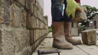 Man Laying Stone Block in Wall video