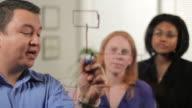Man leading a business presentation video