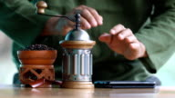 man learning from smart phone how to make drip coffee video
