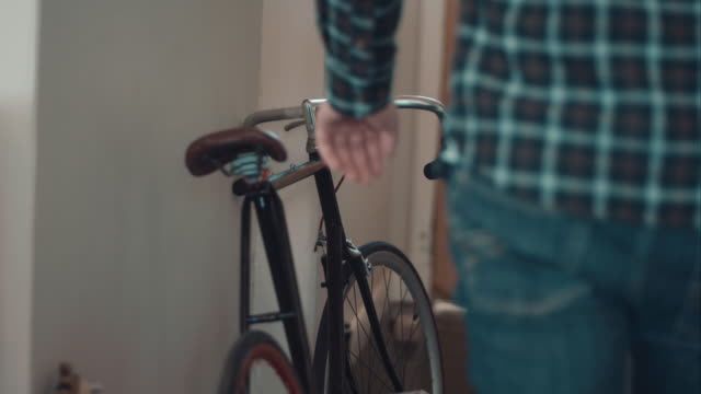 Man leaving home with bike video