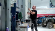 Man lifts the shutter at the yacht centre video
