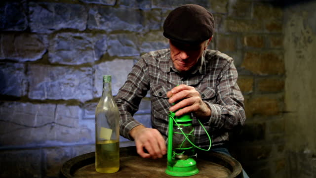 Man lighting up an old oil lamp video