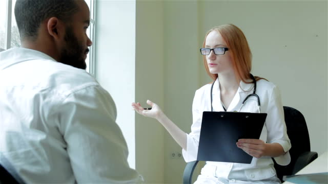 Man listening to consult your doctor video
