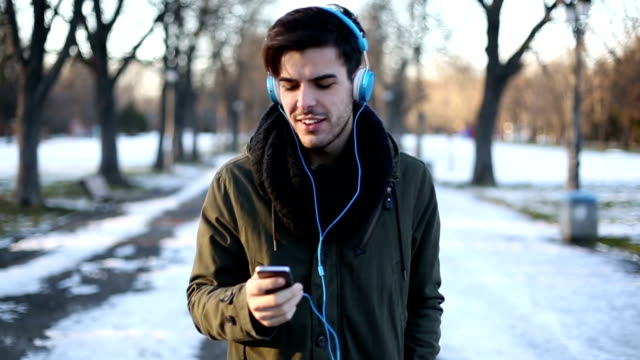 Man listening to the music at the park video