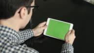 A Man Look a Horizontal Tablet at His Desk video