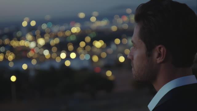 Man looking at city video