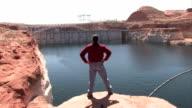 Man looking at Glen Canyon Dam P HD video